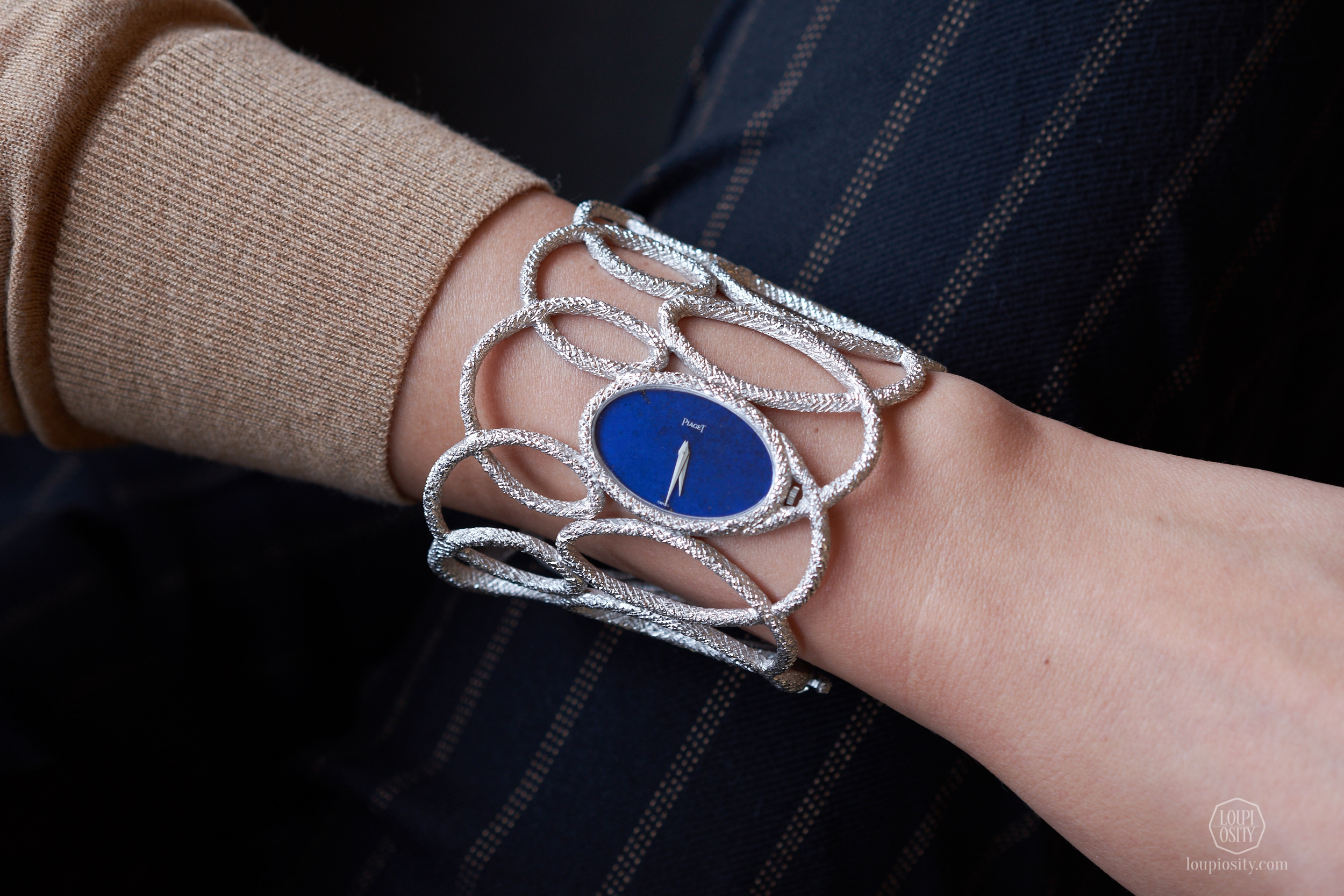 Lots 237 Piaget Manchette white gold openwork textured bangle watch with lapis lazuli dial