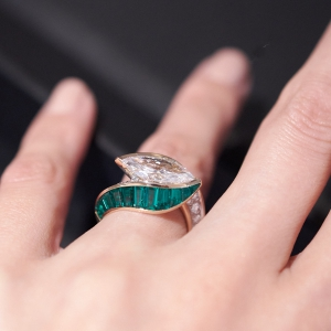 Marquise-cut diamond ring with emeralds