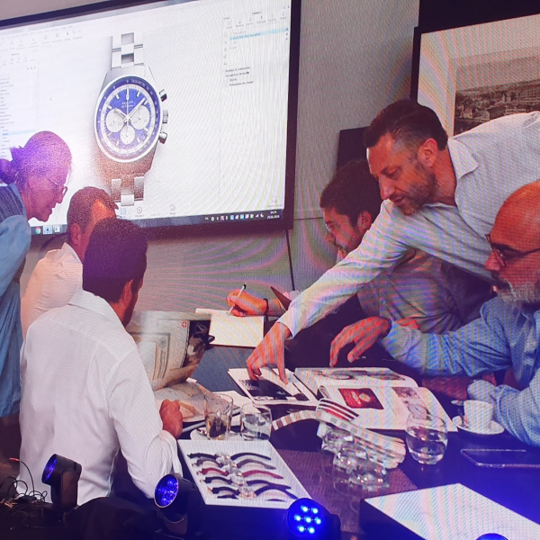 Aurel Bacs and Alexandre Ghotbi going through the archives with the Zenith team
